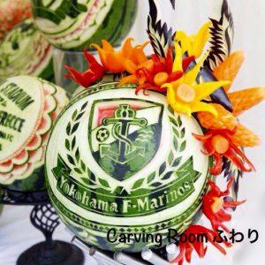 横浜マリノスのイベントでの会場装飾をしたスイカカービング。スイカの周りはベジタブルカービングの花を飾りました。